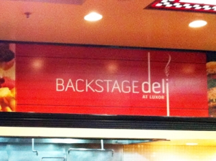 Backstage Deli Restaurant Sign