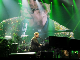 The Focus is on the Right Place, the Man at the Piano""