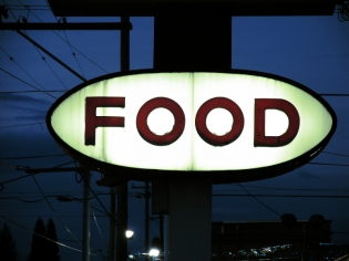 Lit up Food Sign at Night