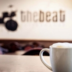 The Beat Coffee and Logo